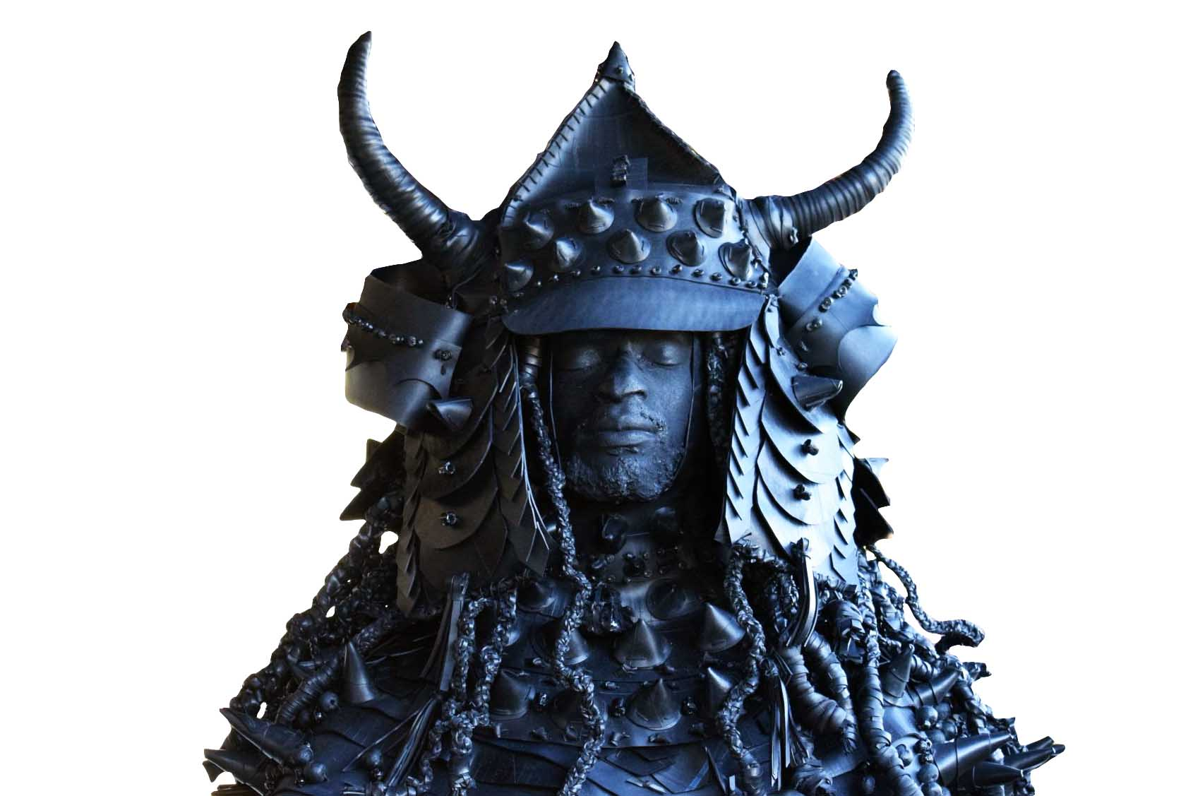 A headshot of another version of Yasuke, the African samurai, wearing a spiked helmet with two upward-facing horns and long dreadlocks.