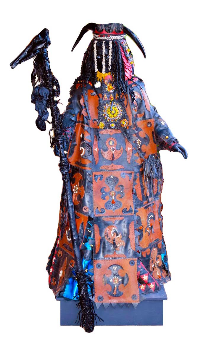 An interpretation of a mysterious Egungun masquerader from West Africa, wearing layered, flowing robes heavily decorated with colourful beadwork and carrying a shamanic totem pole in his right hand.